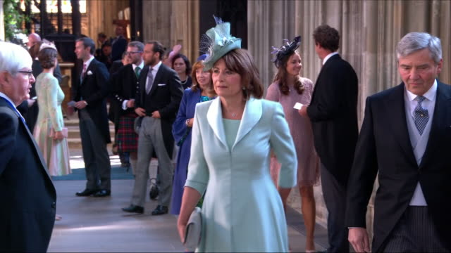 Shows interior shots Carole and Michael Middleton arriving at St George's Chapel for the wedding of Prince Harry Duke of Sussex and Meghan Markle on...