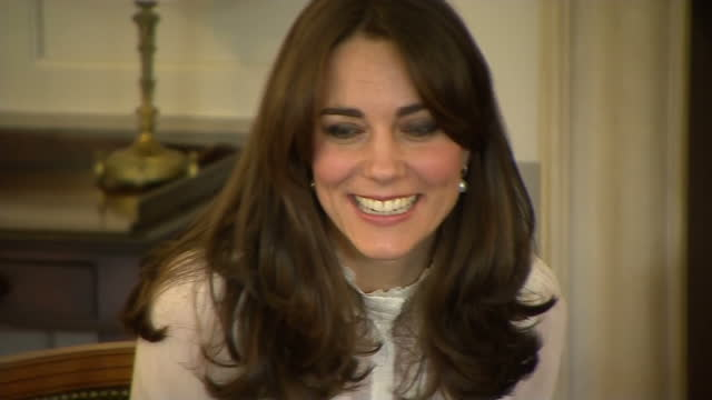 Shows interior shots Catherine Duchess of Cambridge meeting with group of children and representatives from mental health charities The Duchess of...