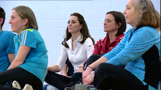 shows interior shots catherine duchess of cambridge performing tennis drills with partner using bean bag and sitting with group watching... - bean bag stock videos and b-roll footage