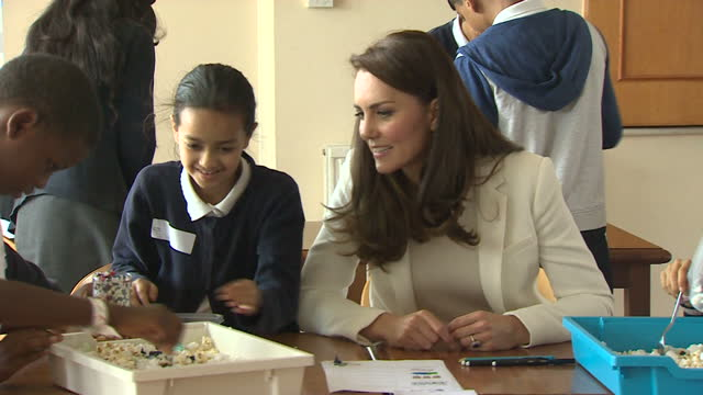 shows interior shots catherine , duchess of cambridge, talking to children in workshop at an 1851 charity event in london docklands. catherine,... - london docklands stock videos & royalty-free footage