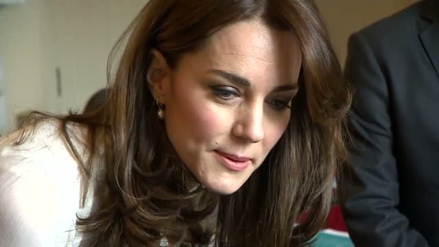 Shows interior shots Catherine Duchess of Cambridge talking with Huffington Post staff as they work at a computer The Duchess of Cambridge is...