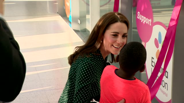 shows interior shots catherine duchess of cambridge with the help of a child unveiling poster celebrating 150 years of the evelina london children's... - christmas poster stock videos & royalty-free footage