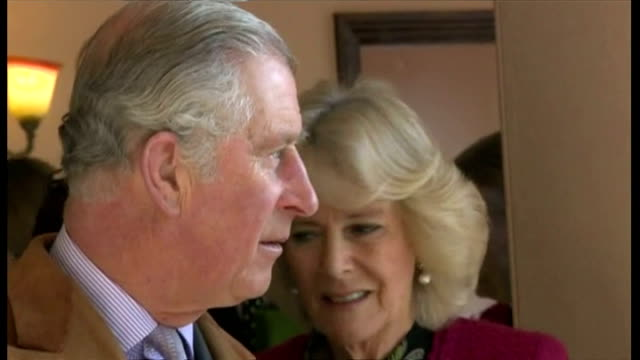 Shows interior shots Charles and Camilla being shown round property damaged in floods under repair and talking to workmen The Prince of Wales is...
