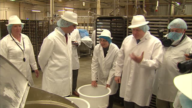 shows interior shots conservative mps and 'out' campaigners priti patel michael gove and boris johnson touring farmhouse biscuits factory with boris... - smelling stock videos & royalty-free footage