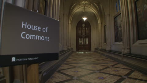 shows interior shots corridors, signs for the various state departments and the house of commons in the houses of parliament in london on 4th... - house of commons stock videos & royalty-free footage