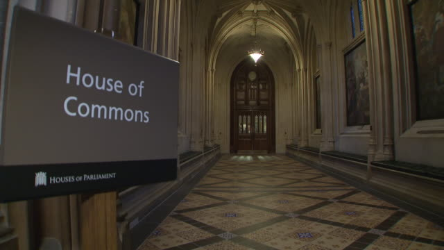 shows interior shots corridors signs for the various state departments and the house of commons in the houses of parliament in london on 4th december... - 庶民院点の映像素材/bロール