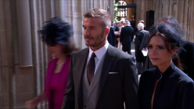 Shows interior shots David Beckham and Victoria Beckham arriving and walking through guests in St George's Chapel at the wedding of Prince Harry Duke...