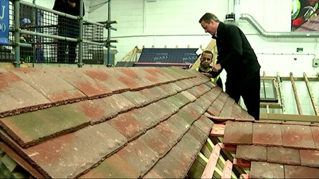 shows interior shots david cameron working on model roof and showing the completed project on january 12 2015 in nottingham england - contea di nottingham video stock e b–roll