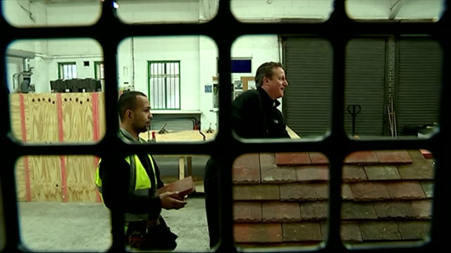 shows interior shots david cameron working on model roof at roofing college on january 12 2015 in nottingham england - contea di nottingham video stock e b–roll