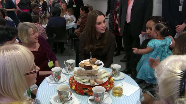 shows interior shots duchess of cambridge sat with foster carers charity workers on january 16 2015 in london england - foster care stock videos & royalty-free footage