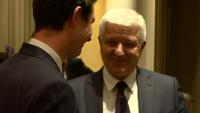shows interior shots dusko markovic, prime minister of montenegro, talking to people and leaving room at bayerischer hof hotel where international... - montenegro stock videos & royalty-free footage
