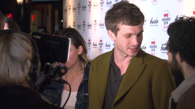 shows interior shots ellie roswell, joff oddie, joel amey and theo ellis of wolf alicespeaking to press on the red carpet. the nme awards 2016 with... - roswell stock videos & royalty-free footage