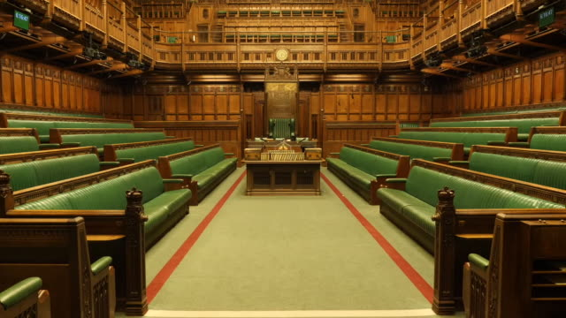 stockvideo's en b-roll-footage met shows interior shots empty debating chamber the house of commons in london includgin green benches table of the house of commons dispatch boxes... - house of commons