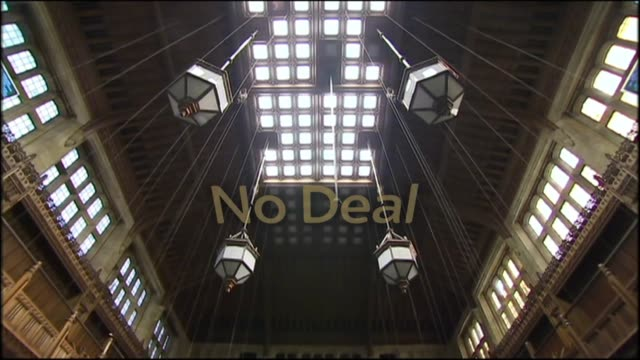 shows interior shots empty house of commons debating chamber including famous green upholstry graphic sequence on what could happen next polotically... - 庶民院点の映像素材/bロール