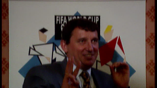 shows interior shots england football manager graham taylor arriving and sitting at table for press conference and posing for photo opportunity on... - major league soccer stock videos and b-roll footage