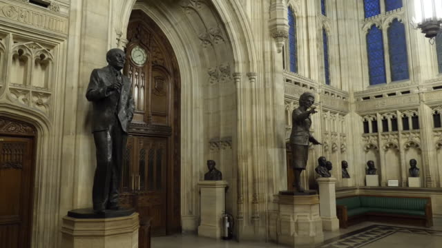 shows interior shots entrance doors to the house of commons debating chamber statues and busts of various politicians including margaret thatcher... - 庶民院点の映像素材/bロール