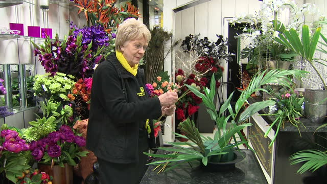 Shows interior shots florist in flower shop arranging flowers and leaves in display on 21st February 2017 in Preston Lancashire England