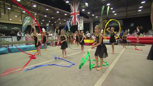 Shows interior shots girls practising artistic gymnastics with ribbons at free 'I am Team GB' event in Coventry Olympians returning in glory from Rio...