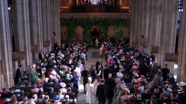 vídeos de stock, filmes e b-roll de shows interior shots guests finding their seats in st george's chapel before the wedding of prince harry duke of sussex and meghan markle on the 19th... - hóspede