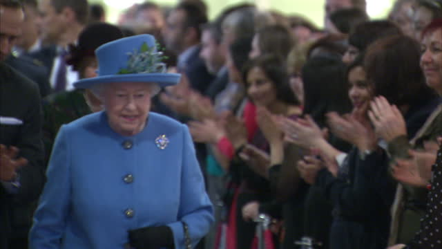 shows interior shots home office employees clapping as queen elizabeth ii of great britain walks past. interior shots civil servants lined up on... - other stock videos & royalty-free footage