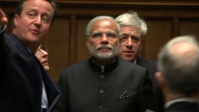 shows interior shots indian prime minister narendra modi being shown round house of commons by british prime minister david cameron and speaker of... - house of commons stock videos & royalty-free footage