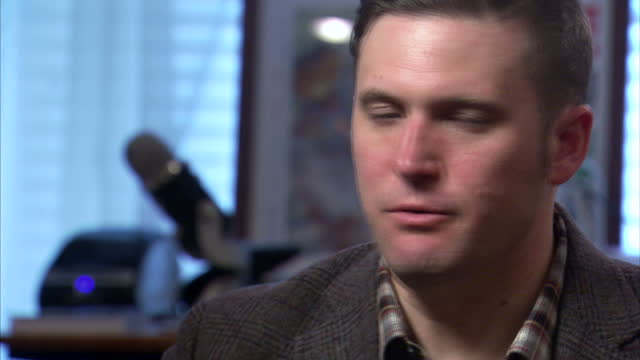 Shows interior shots interview soundbite with 'altright' and White Nationalist Leader Richard Spencer speaking on Trump's Muslim travel ban After...