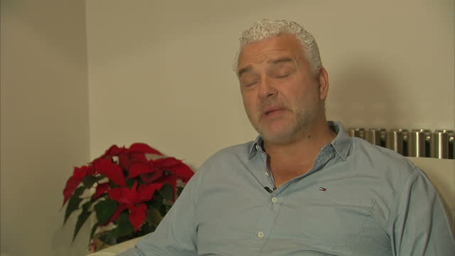 Shows interior shots interview soundbite with former footballer and abuse victim Paul Stewart speaking on number of people coming forward with sexual...