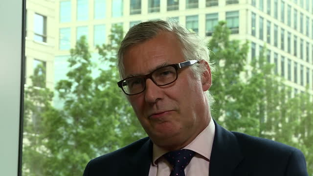 shows interior shots interview soundbite with regulatory partner at clifford chance simon gleeson speaking on impact of brexit comparing it to the... - chance stock videos and b-roll footage