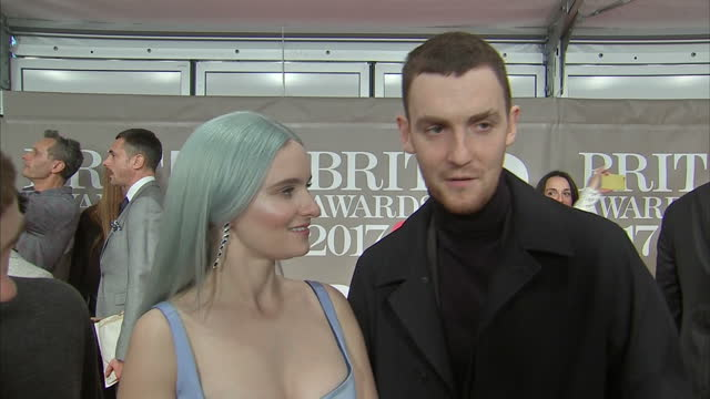 shows interior shots interview with clean bandit speaking on the awards show and their single 'rockabye' on red carpet at brit awards 2017 on 22nd... - ブリット・アワード点の映像素材/bロール