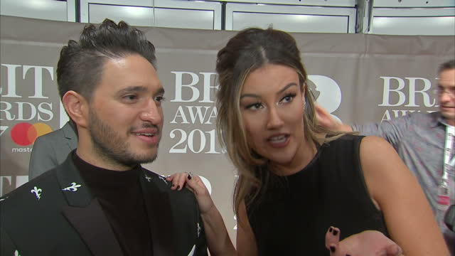 shows interior shots interview with jonas blue and dakota speaking on nomination on red carpet at brit awards 2017 on 22nd february 2017 in the o2... - ブリット・アワード点の映像素材/bロール