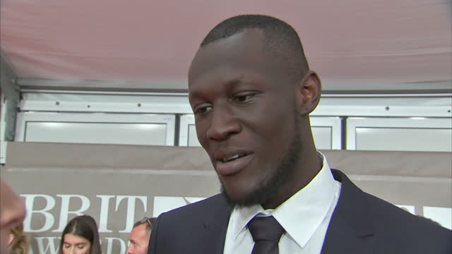 shows interior shots interview with stormzy speaking on awards and nomination on red carpet at brit awards 2017 on 22nd february 2017 in the o2 arena... - ブリット・アワード点の映像素材/bロール