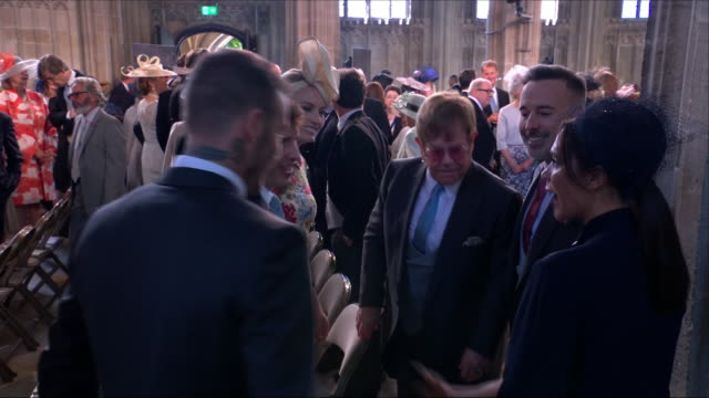 Shows interior shots James Blunt Sofia Wellesley Elton John David Furnish Victoria Beckham and David Beckham chatting in St George's Chapel at the...