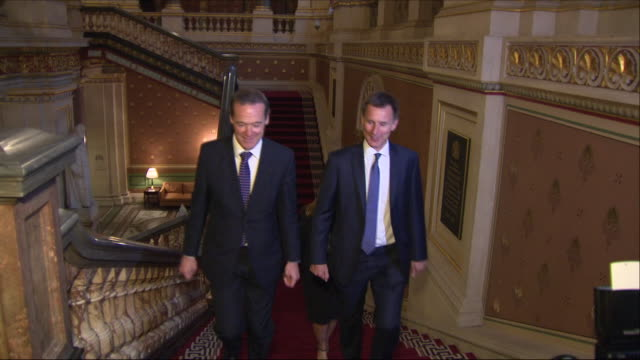 shows interior shots jeremy hunt mp, uk's foreign secretary, walking with senior civil servant simon mcdonald up the grand staircase in the foreign... - grand staircase escalante national monument stock-videos und b-roll-filmmaterial