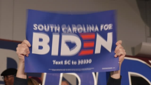 shows interior shots joe biden supporters at rally waving signs and posters and letters spelling out his name during campaign event for south... - spelling stock videos & royalty-free footage