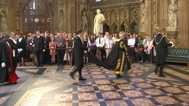 shows interior shots john bercow speaker of the house walk through the central lobby of the houses of parliament with the serjeant at arms carrying... - the queen's speech state opening of uk parliament stock videos & royalty-free footage
