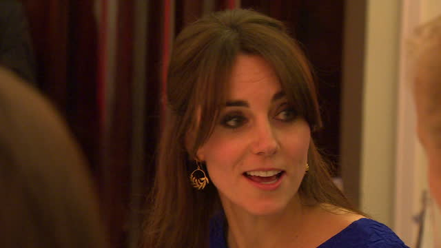 Shows Interior shots Kate Catherine Duchess of Cambridge entering dining room and sitting down at table talking to other diners Interior shots Kate...