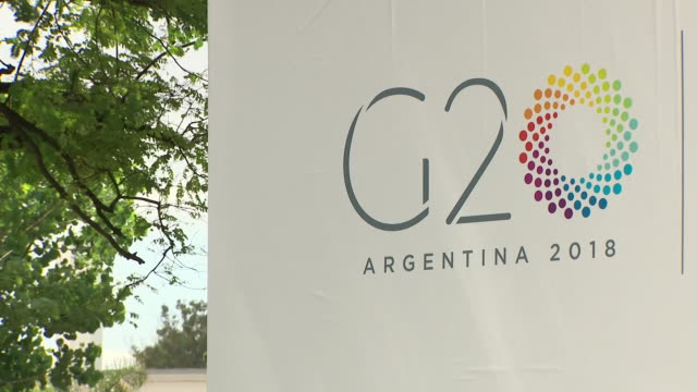 shows interior shots logos flags posters and welcome signs at the g20 summit in buenos aires argentina theresa may is currently in argentina at the... - group of 20 stock videos & royalty-free footage