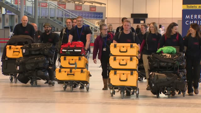 Shows interior shots medics and doctors from the UKEMT at Manchester airport with boxes of medical supplies and equipment ready to depart for...