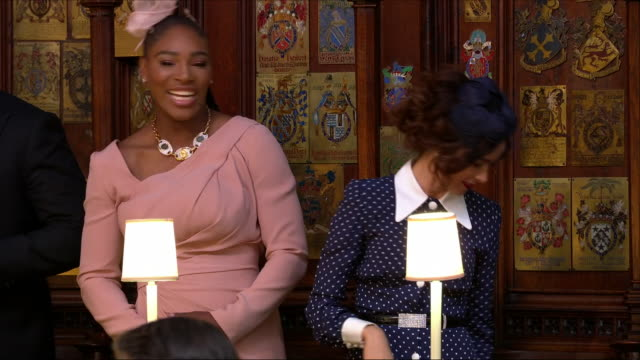 Shows interior shots Meghan's friends actress Abigail Spencer and Tennis player Serena Williams finding seats in St George's Chapel before the...