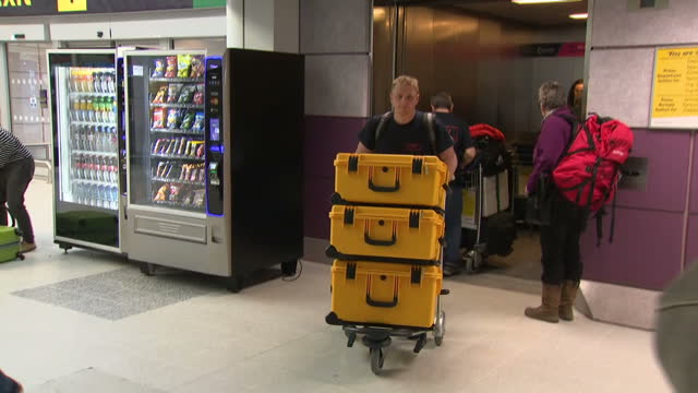 Shows interior shots meidcs and doctors members of the UKEMT at Manchester airport with boxes of medical supplies and equipment ready to depart for...
