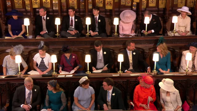 Shows interior shots members of the British Royal Family sitting in St George's Chapel including Prince Edward Duke of Wessex James Viscount Severn...