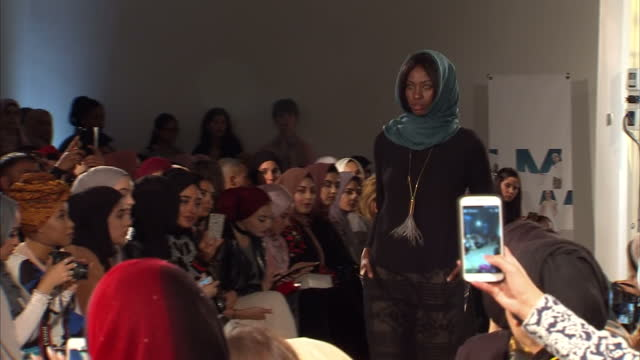 shows interior shots models on catwalk at the london fashion week dressed in outfits from 'modest' fashion lines designed to adhere to islamic... - fashion show stock videos & royalty-free footage