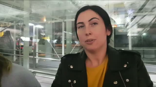 shows interior shots passengers on delayed and cancelled flights in the terminal at stansted airport sleeping sitting looking bored and voxpops... - media interview stock videos and b-roll footage