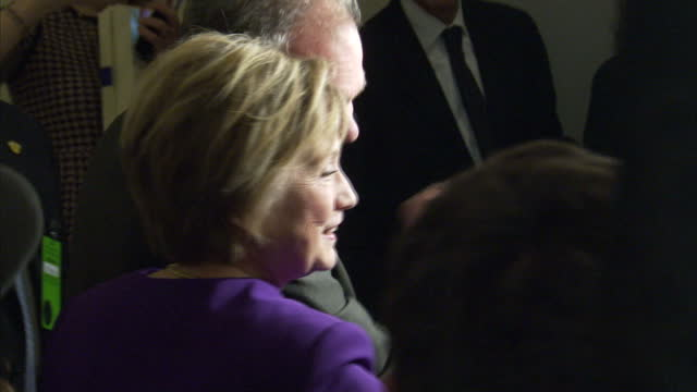 shows interior shots people surrounding, talking to and taking photos of and with former us secretary of state hillary clinton following senator... - tribute event stock videos & royalty-free footage