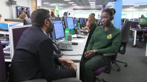 vídeos y material grabado en eventos de stock de shows interior shots people working in the west midlands ambulance service 111 health call centre and interview with one of them speaking on rise in... - reportaje imágenes