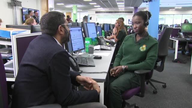 shows interior shots people working in the west midlands ambulance service 111 health call centre and interview with one of them speaking on rise in... - west midlands stock-videos und b-roll-filmmaterial