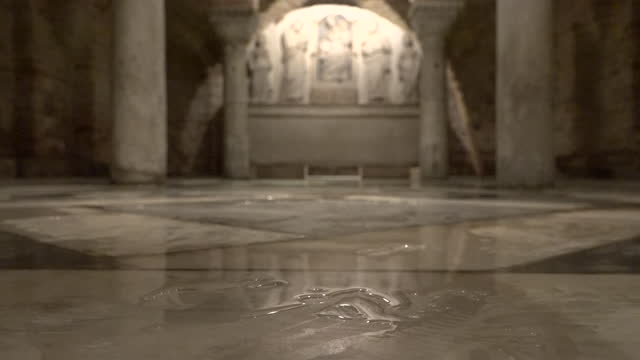 shows interior shots pools of water on marble floor of shrine in the basement of st mark's basilica and the aftermath of flooding which filled the... - crypt stock videos & royalty-free footage