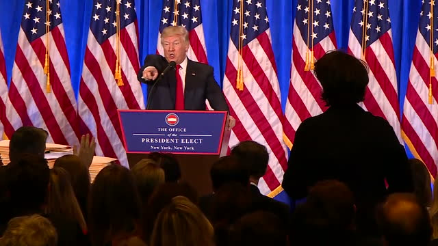 "shows interior shots president elect donald trump giving press conference, telling journalists to stop being rude and quote: ""you are fake news"".... - press conference stock videos & royalty-free footage"