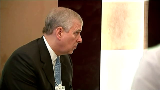 shows interior shots prince andrew sat at a table talking with his associates on january 22 2015 in davos switzerland - ダボス点の映像素材/bロール