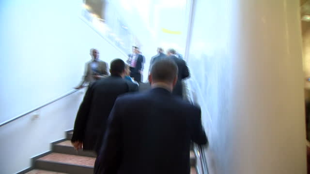 Shows interior shots Prince Andrew walking through lobby of World Economic Forum event continuing up the stairs on January 22 2015 in Davos...